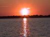 zachodzące słońce w aureoli